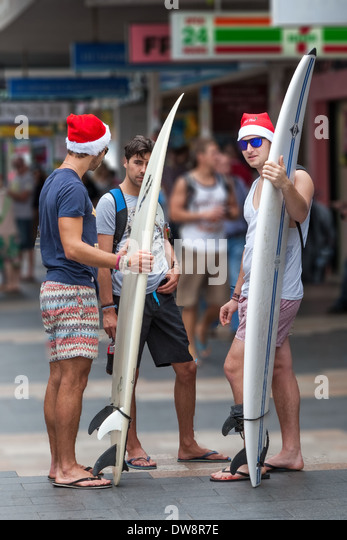 Surfers at Christmas The Corso Manly Australia - Stock Image