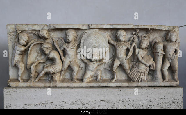 Sarcophagus. Cupids making and carrying weapons. Marble. 2nd C. AD. Antonine Age. National Roman Museum. Baths of - Stock Image