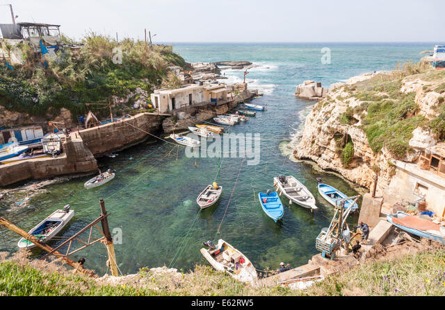 A small fishing village community and harbour on the Mediterranean coast, with moored boats outside Beirut, Lebanon - Stock Image