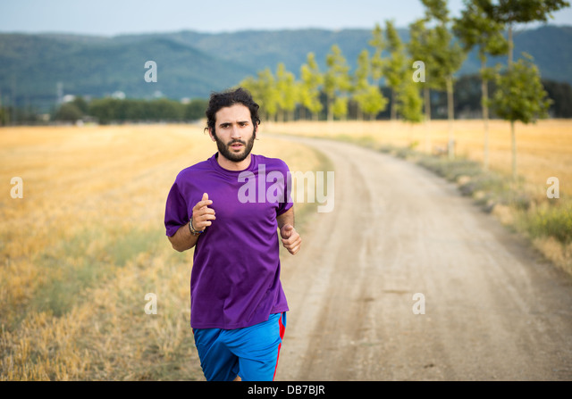 Young athletic man running in the nature - Stock-Bilder