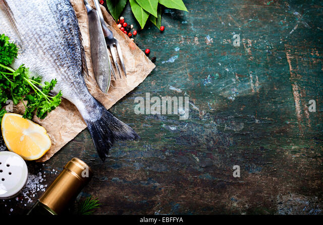 Food background with Fish and Wine. Lots of copy space - Stock Image