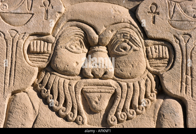 Egyptian god is depicted on the exterior wall of the Temple of Isis at Philae, Egypt. - Stock Image