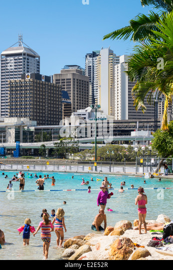 Australia Queensland Brisbane Southbank Parklands Streets Beach sunbathers sand water Central Business District - Stock Image