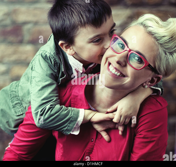 Joyful mother with her cute son - Stock Image