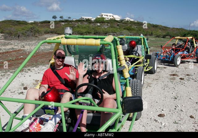 Grand Turk Cockburn Town dune buggy excursion tour couple helmets - Stock Image