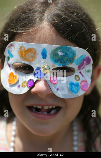 Florida, Zydeco Festival, Cajun, girl, Mardi Gras mask, - Stock Image