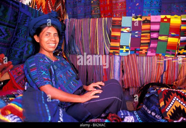 Woman Maya Indian Textile Shop Panajachel Guatemala Central America colorful scarfs blanket textiles trade - Stock Image