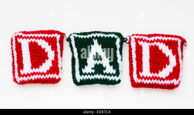"Knitted woollen lettering spelling ""Dad"". - Stock Image"