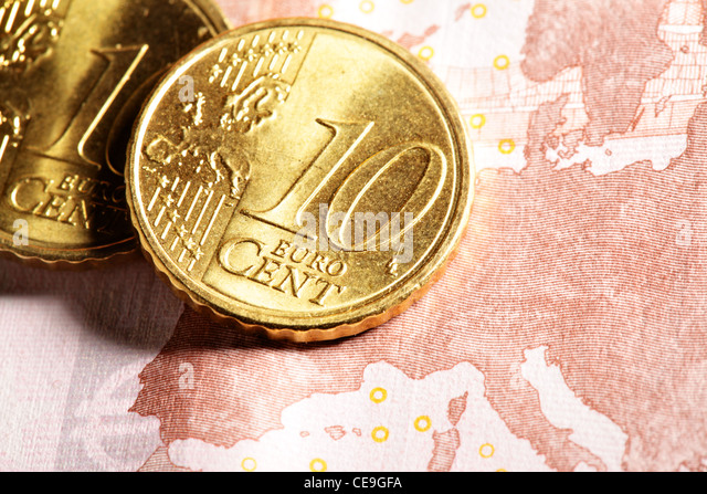 Euro zone - Ten euro cent coins close up on bank note  - Stock Image