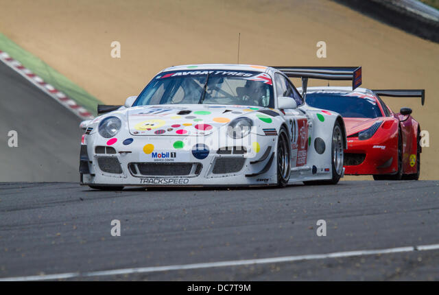 Trackspeed Porsche 997 entering Druids bend during BritishGT at Brands Hatch in the UK - Stock Image
