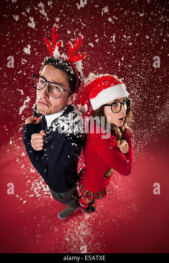Freezing nerd couple during the snowing  Debica, Poland - Stock Image