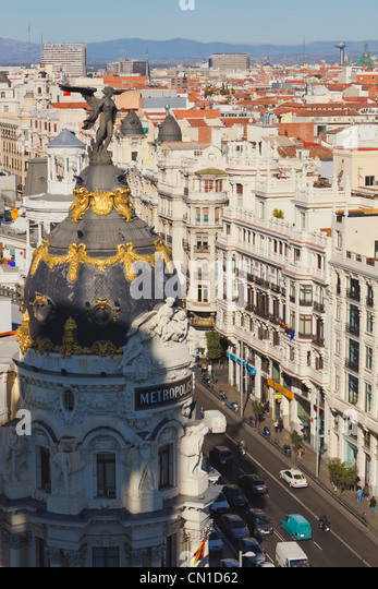 Madrid, Spain. The dome and angel of the Metropolis building. Gran Via on right. - Stock Image