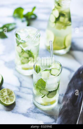 Green sangria with melon, cucumber, basil, mint, grapes and lime drink. - Stock Image