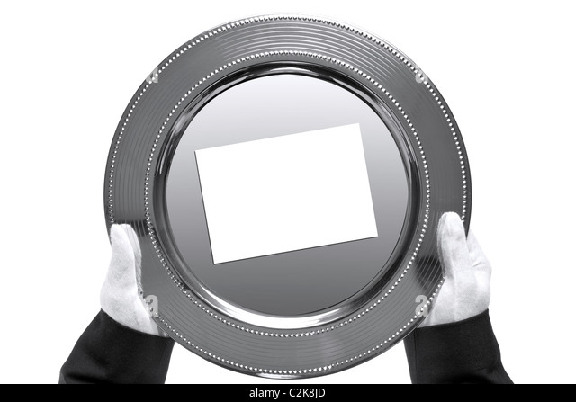 Photo of a silver tray with blank card on being held by a butler, shot from above and isolated on a white background. - Stock Image