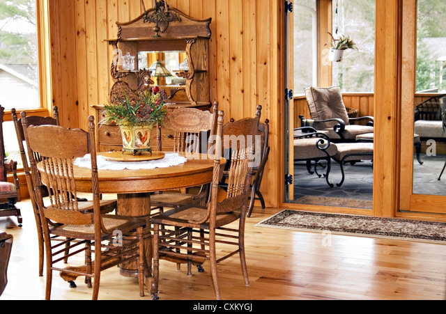 A great room with views of the dining, and screened porch areas. - Stock Image