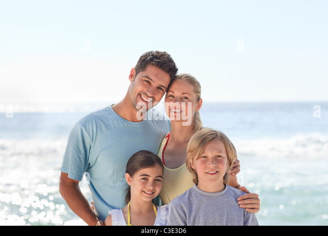 Joyful family at the beach - Stock Image