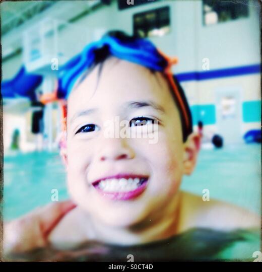 Boy in pool - Stock Image