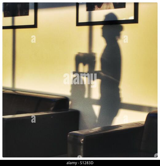 Shadow of a waitress carrying drinks - Stock Image