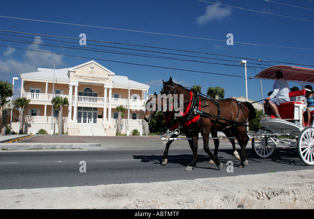 Grand Turk Cockburn Town Queen Street Francis Building Parliament horse drawn tour carriage - Stock Image