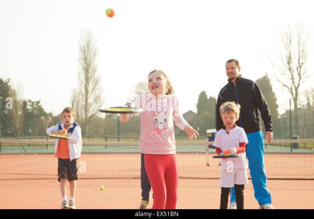 Children Practicing Tennis - Stock Image