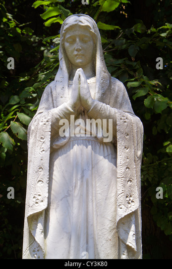 Maine South Portland Calvary Cemetery Roman Catholic Diocese of Portland statue praying woman religion Christian - Stock Image
