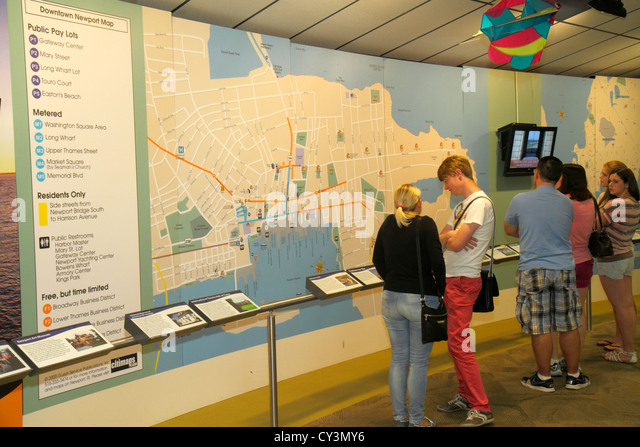 Rhode Island Newport Discover Newport Visitors Center map information exhibit man woman family - Stock Image