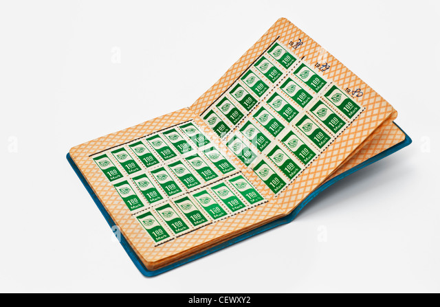 Fee stamps in a membership book of the GDR mass organization the Society for German-Soviet Friendship. - Stock Image