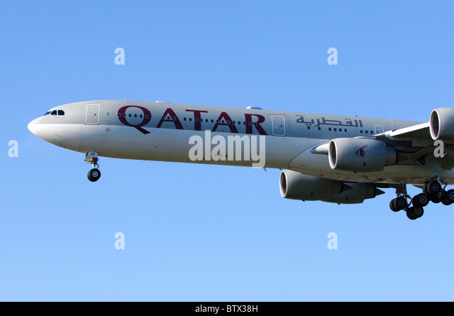 Airbus A340 operated by Qatar Airlines on approach for landing at London Heathrow Airport - Stock Image