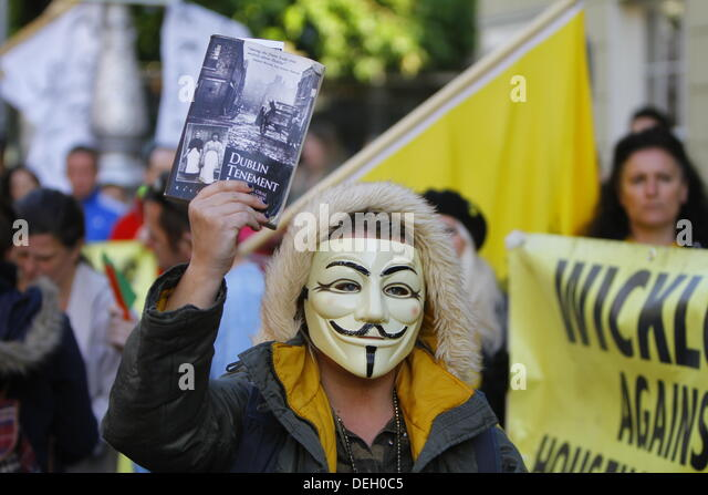 Dublin, Ireland. 18th September 2013. A protester is pictured, wearing a Guy Fawkes mask and holding a book about - Stock Image