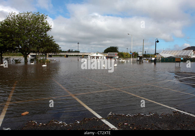 Local restaurant and car park floods after heavy rains in Dorset and South West England - Stock Image