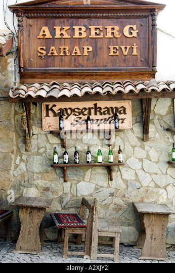 Locally produced wines are offered for sale in small wine shops in the village of Sirince Turkey - Stock Image