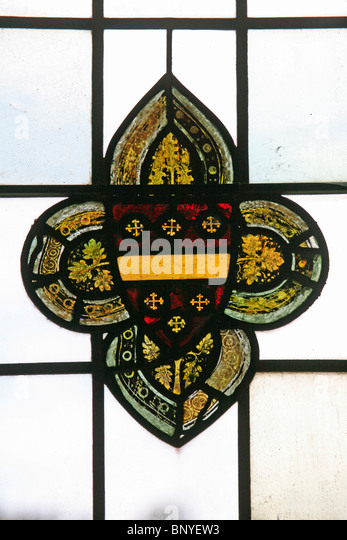 A medieval stained glass window depicting the coat of Arms of Richard de Beachamp, 13th Earl of Warwick - Stock Image