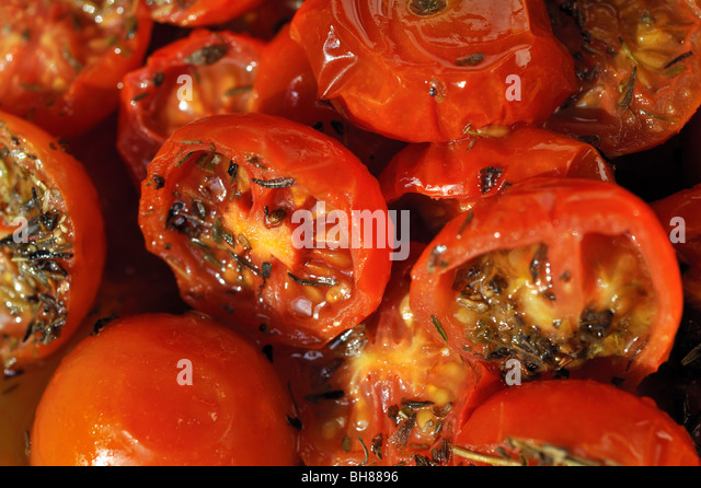 HOME MADE SUN DRIED TOMATOES - Stock Image