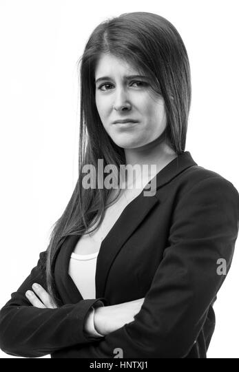 monochrome studio portrait of a woman, her expression is very disgusted or worried because something's wrong - Stock Image