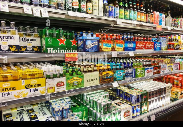 Hawaii Hawaiian Honolulu Waikiki Beach ABC Stores inside interior sale display beer alcoholic beverages bottles - Stock Image