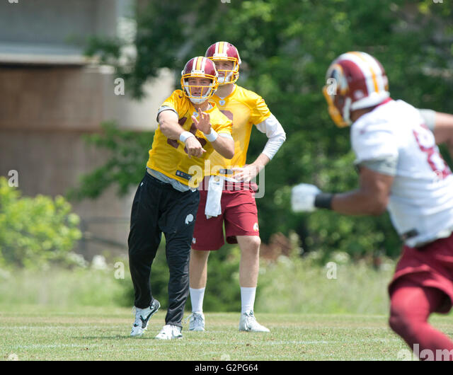 Washington Redskins quarterback Colt MCCoy (16) participates in an organized team activity (OTA) at Redskins Park - Stock Image