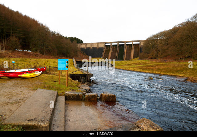 Yorkshire Water Companies Thruscross Reservoir Dam releasing water into the River Washburn for Wild water Canoeing,only - Stock Image