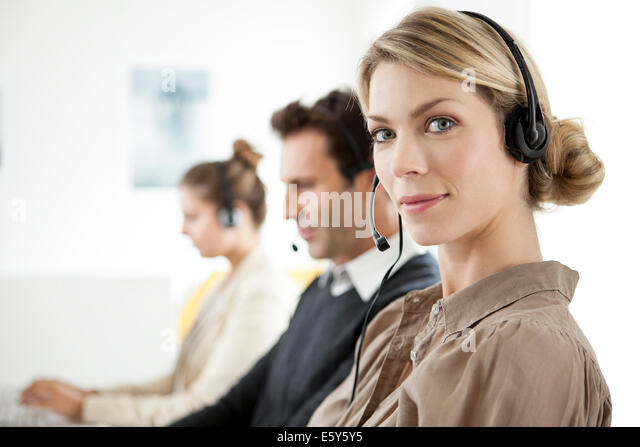 Customer service agent working in call center - Stock Image