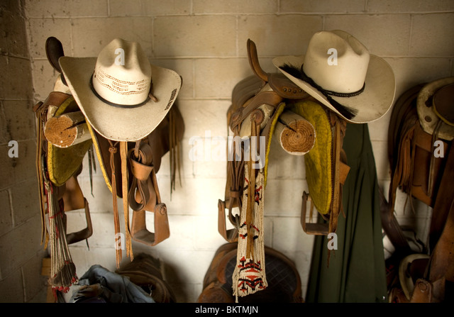 Cowboy hats sit on horse saddles in a stable in Tepotzotlan, Mexico, May 3, 2008. Photo/Chico Sanchez - Stock Image