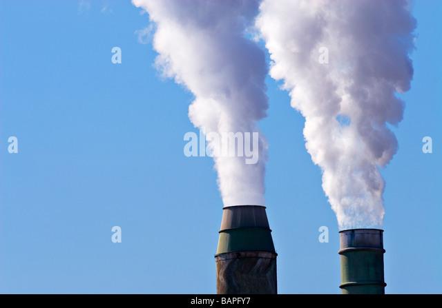 Industrial Pollution / Two smokestacks spew toxic smoke into the air.Geelong Victoria Australia. - Stock Image