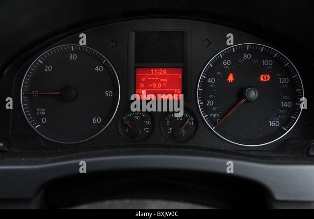 Car dashboard thermometer reading minus -9.0 centigrade - Stock Image