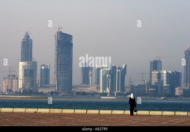 Qatar Doha bay skyline arabian woman - Stock Image