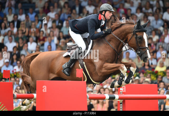 Aachen, Germany. 23rd Aug, 2015. Ben Maher of Great Britain jumps with his horse Diva over an obstacle in the Show - Stock Image