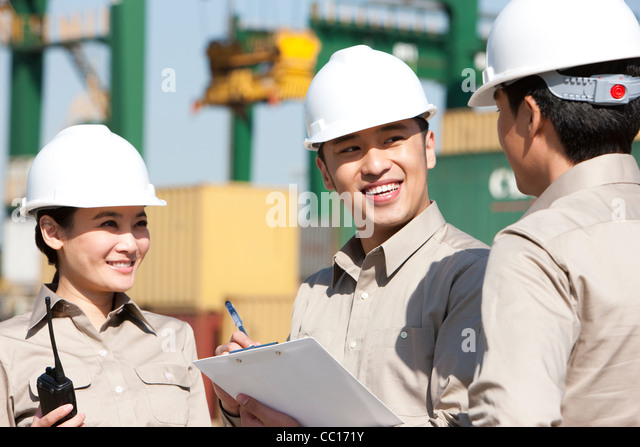 shipping industry workers at work - Stock Image