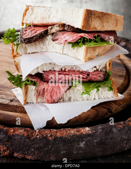 Roast beef sandwich with lettuce - Stock Image