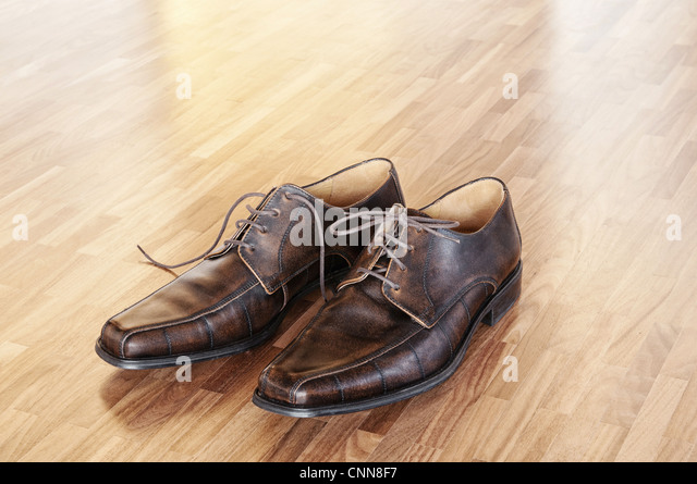 A pair of brown shoes in a home interior. - Stock Image