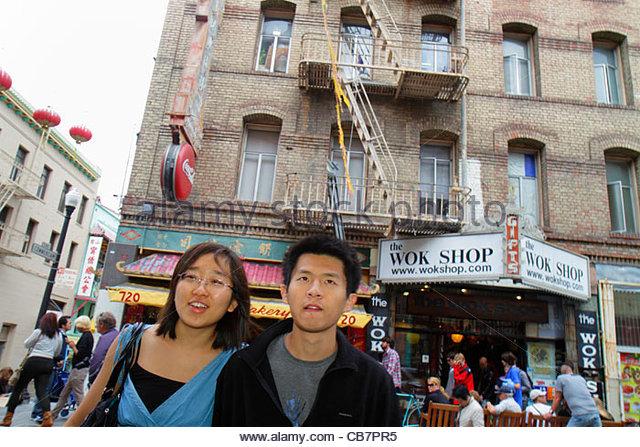 California San Francisco Chinatown Grant Street ethnic neighborhood business shopping Asian man woman couple pedestrian - Stock Image