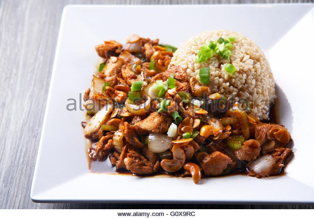 Chicken with cashews,almonds,and brown rice - Stock Image