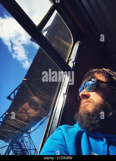 Hipster guy on train journey - Stock-Bilder