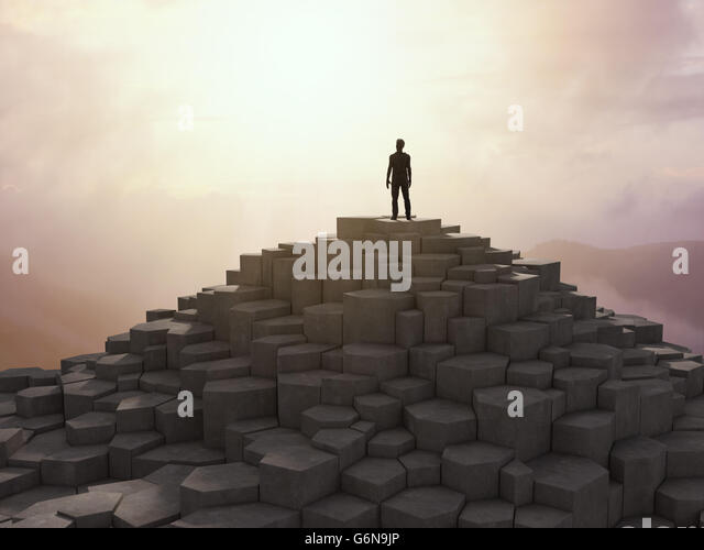 Tiny man figure standing on a rocky top of a mountain - 3D illustration - Stock-Bilder